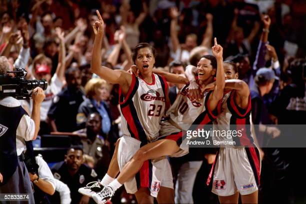 The Houston Comets celebrate at center court after winning the 1997 WNBA Finals at the Compaq Center circa 1997 in Houston Texas NOTE TO USER User...