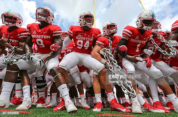 The Houston Cougars perform a pregame chain chant before playing against the Lamar Cardinals in the first quarter at TDECU Stadium on September 10...