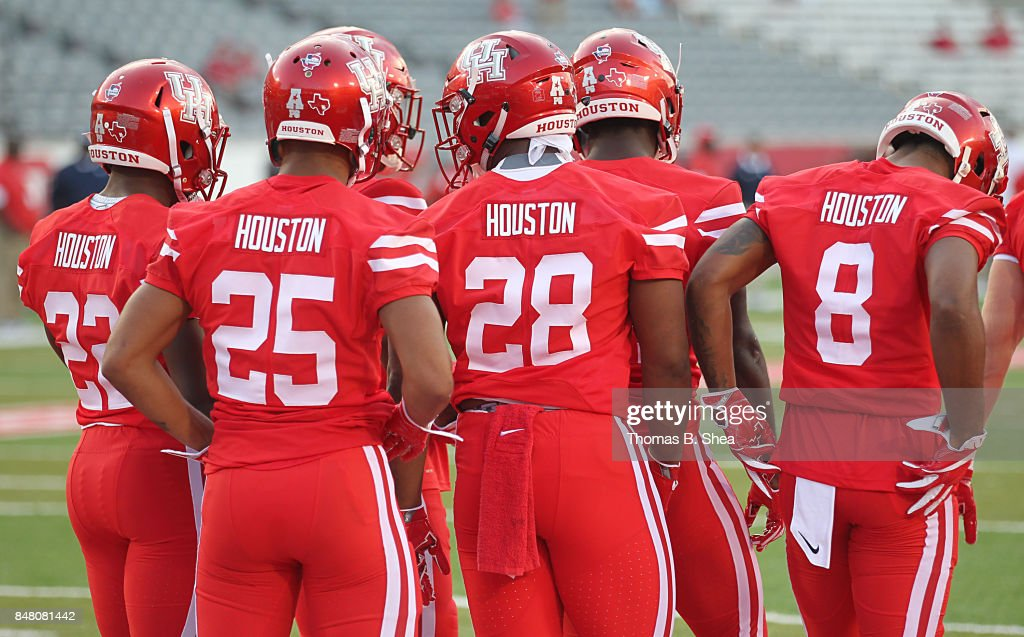 The Houston Cougars wear the name 'Houston' on their back of the jerseys in honor of the sane 'Houston Strong' before the Cougars play against the Rice Owls at TDECU Stadium on September 16, 2017 in Houston, Texas.