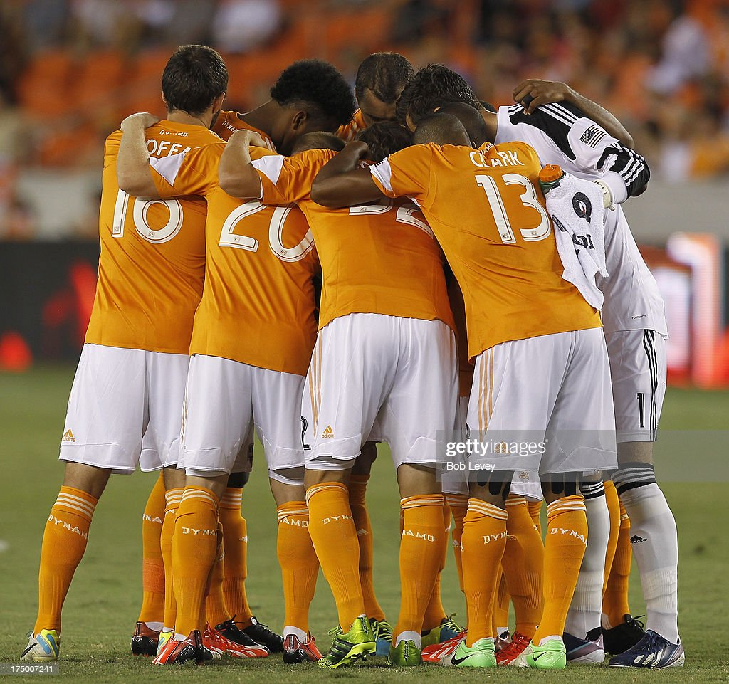 The Houston Dynamo huddles up before the opening whistle against the Chicago Fire at BBVA Compass Stadium on July 27, 2013 in Houston, Texas.