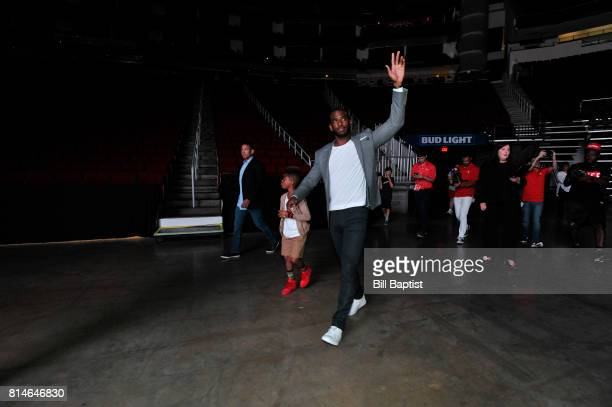 The Houston Rockets Chris Paul and son Lil Chris waves to the fans on July 14 2017 at the Toyota Center in Houston Texas NOTE TO USER User expressly...