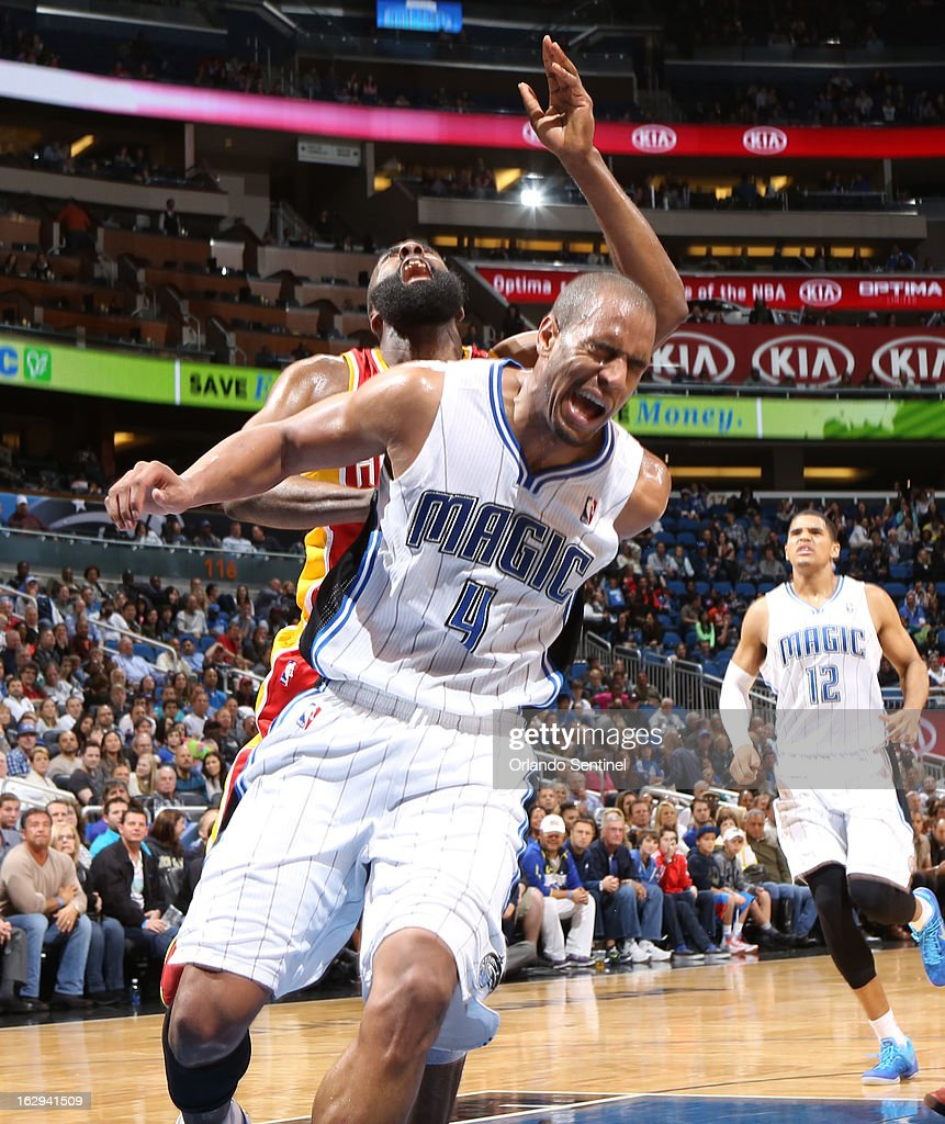 The Houston Rockets' James Harden and the Orlando Magic's Arron Afflalo (4) collide in the paint during the second half at the Amway Center in Orlando, Florida, on Friday, March 1, 2013. Houston defeated Orlando, 118-110.