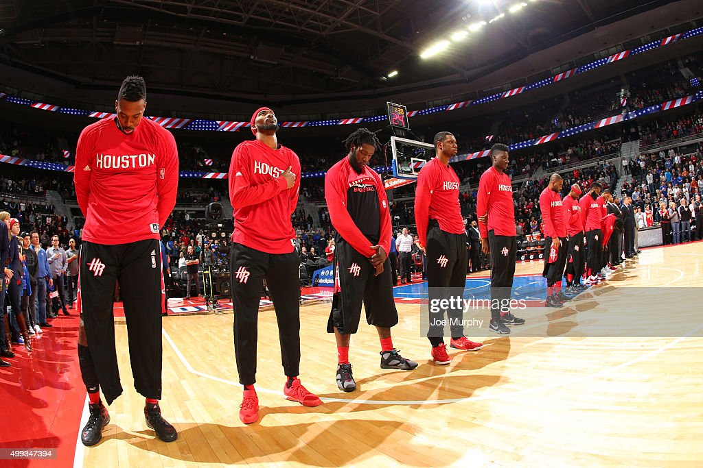 The Houston Rockets stand for a moment of silence for the National Anthem before the game against the Detroit Pistons on November 30 2015 at the...
