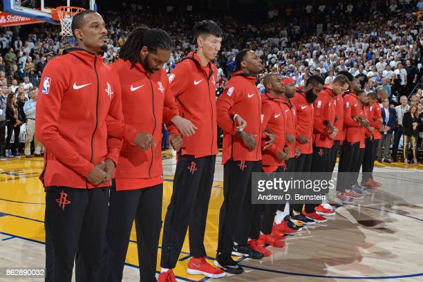 The Houston Rockets stand on the court for the National Anthem before the game against the Golden State Warriors on October 17 2017 at ORACLE Arena...