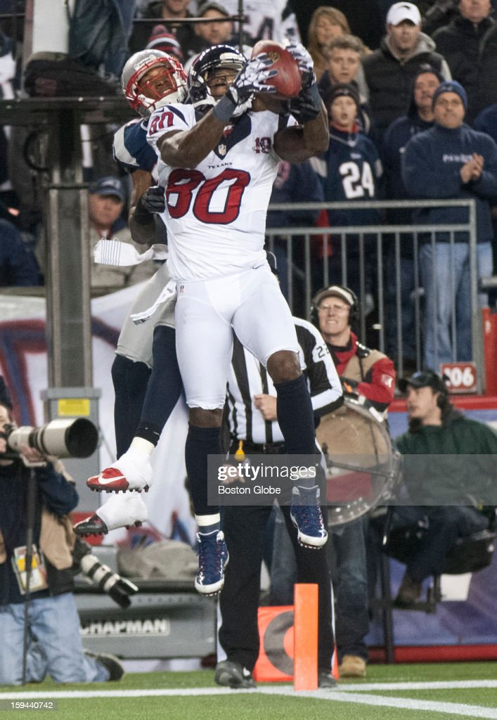 The Houston Texans' Andre Johnson leaps over the New England Patriots' Aqib Talib for a 2-point conversion during fourth quarter action as the New England Patriots hosted the Houston Texans in an NFL AFC Divisional Playoff Game at Gillette Stadium, Jan. 13, 2013.