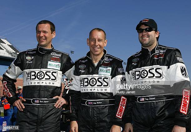 The HowardBoss Motorsports Pontiac Crawford drivers Butch Leitzinger Andy Wallace and Tony Stewart pose for photographers prior to the 2006 Rolex 24...
