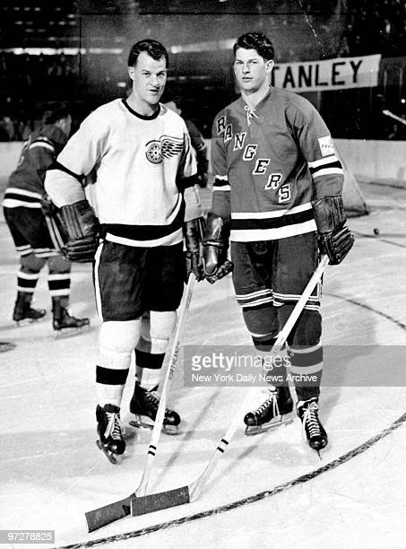 The Howe brothers face each other on the ice On left is Gordie Howe of the Detroit Red Wings and on right is Vic Howe of the New York Rangers circa...