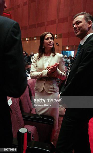 The HRH Crown Princess Mary of Denmark listens to Nicolai Ruge Danish Ambassador to Malaysia during The Women Deliver Conference on May 28 2013 in...