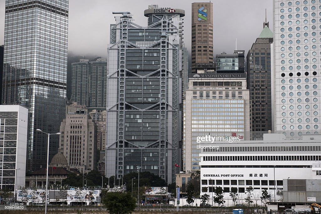 The HSBC Holdings Plc headquarters building, center, stands in Hong Kong, China, on Saturday, Feb. 13, 2016. HSBC's board will meet on Sunday to decide whether to shift its headquarters from London, according to two people with knowledge of the decision. Photographer: Xaume Olleros/Bloomberg via Getty Images