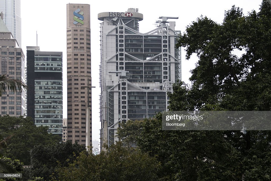 The HSBC Holdings Plc headquarters building, right, stands in Hong Kong, China, on Saturday, Feb. 13, 2016. HSBC's board will meet on Sunday to decide whether to shift its headquarters from London, according to two people with knowledge of the decision. Photographer: Xaume Olleros/Bloomberg via Getty Images