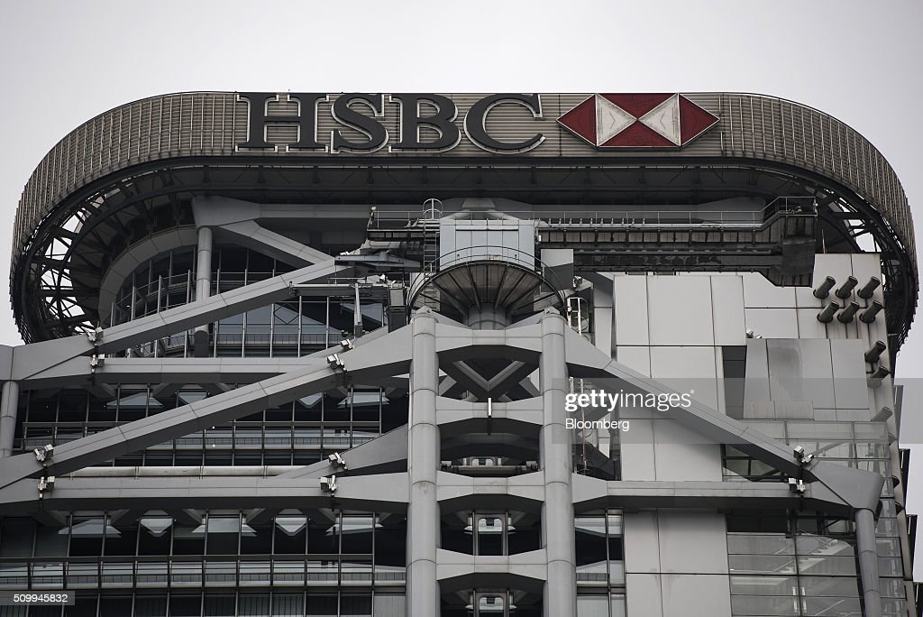 The HSBC Holdings Plc logo is displayed atop of the company's headquarters building in Hong Kong, China, on Saturday, Feb. 13, 2016. HSBC's board will meet on Sunday to decide whether to shift its headquarters from London, according to two people with knowledge of the decision. Photographer: Xaume Olleros/Bloomberg via Getty Images
