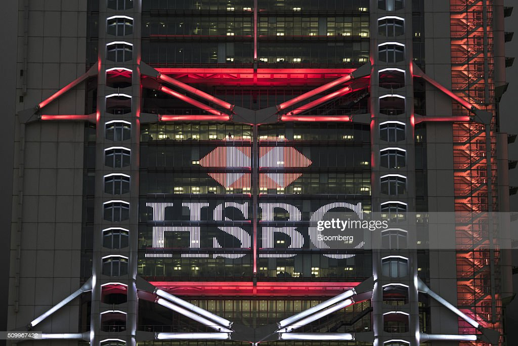 The HSBC Holdings Plc logo is displayed on the company's headquarters building at night in Hong Kong, China, on Saturday, Feb. 13, 2016. HSBC's board will meet on Sunday to decide whether to shift its headquarters from London, according to two people with knowledge of the decision. Photographer: Xaume Olleros/Bloomberg via Getty Images