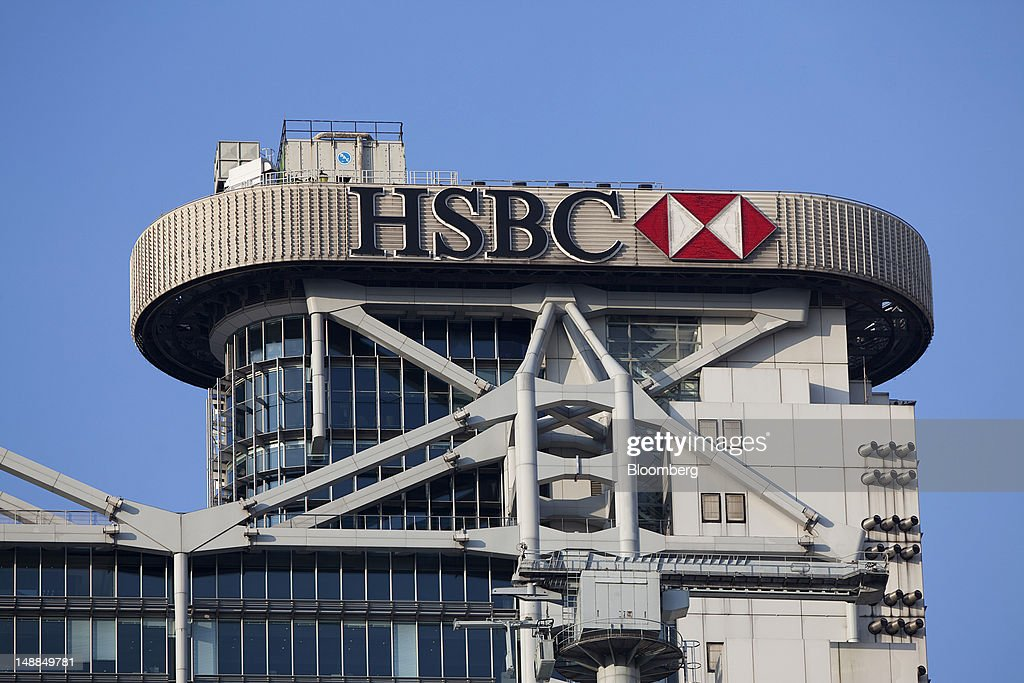 The HSBC Holdings Plc logo is displayed on top of the company's headquarters in Hong Kong, China, on Friday, July 20, 2012. Traders at Deutsche Bank AG, HSBC Holdings Plc, Societe Generale SA and Credit Agricole SA are under investigation for interest-rate manipulation in a global probe that led to a record fine for Barclays Plc last month, a person with knowledge of the matter said. Photographer: Jerome Favre/Bloomberg via Getty Images