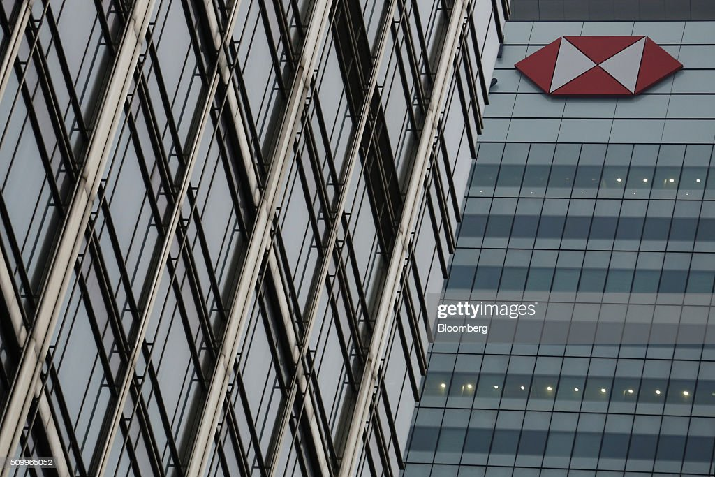 The HSBC Holdings Plc logo sits on the side of the company headquarters in the Canary Wharf business, financial and shopping district in London, U.K., on Saturday, Feb. 13, 2016. HSBC's board will meet on Sunday to decide whether to shift its headquarters from London, according to two people with knowledge of the decision. Photographer: Luke MacGregor/Bloomberg via Getty Images