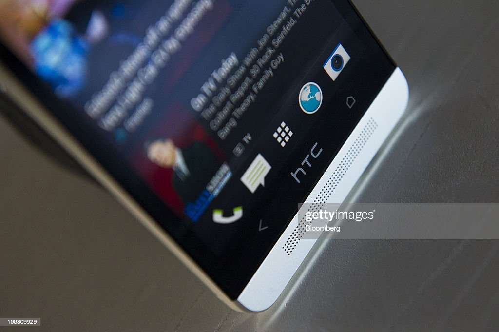 The HTC Corp. One smartphone is displayed for a photograph in San Francisco, California, U.S., on Thursday, April 11, 2013. The HTC Corp. One is among the initial handful of phones compatible with Facebook's new Home software. Photographer: David Paul Morris/Bloomberg via Getty Images