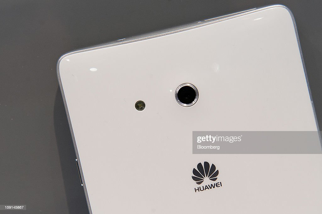 The Huawei Technologies Co. logo is displayed on the back of the company's Ascend Mate smartphone in an arranged photograph at the 2013 Consumer Electronics Show in Las Vegas, Nevada, U.S., on Tuesday, Jan. 8, 2013. The 2013 CES trade show, which runs until Jan. 11, is the world's largest annual innovation event that offers an array of entrepreneur focused exhibits, events and conference sessions for technology entrepreneurs. Photographer: David Paul Morris/Bloomberg via Getty Images
