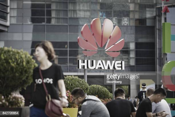 The Huawei Technologies Co logo is displayed outside the Huawei Connect 2017 conference in Shanghai China on Tuesday Sept 5 2017 Huawei Technologies...