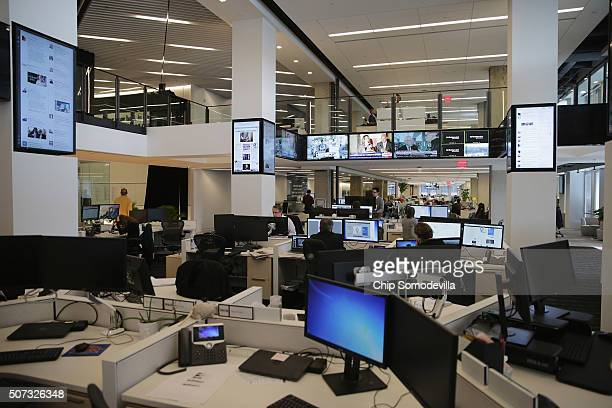 The 'Hub' inside the Washington Post's news room brings editors into a common space and allows them to keep track of breaking news and digital media...