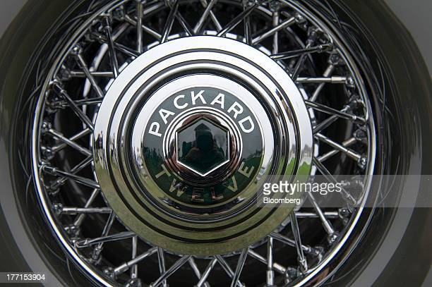 The hubcap and rim of the 1934 Packard 1108 Twelve Dietrich Convertible Victoria is displayed for a photograph after being awarded the Best Of Show...