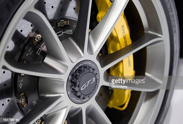 The hubcap of a Porsche AG GT3 vehicle is seen during the 2013 New York International Auto Show in New York US on Thursday March 28 2013 The 113th...