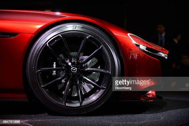 The hubcap of the Mazda Motor Corp RXVision concept vehicle is seen at the Tokyo Motor Show in Tokyo Japan on Wednesday Oct 28 2015 Toyota Motor Corp...
