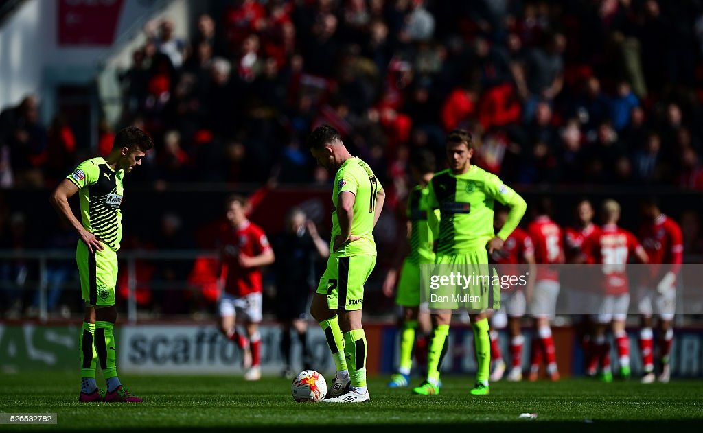The Huddersfield Town players stand dejected after conceeding a fourth goal during the Sky Bet Championship match between Bristol City and Huddersfield Town at Ashton Gate on April 30, 2016 in Bristol, England.