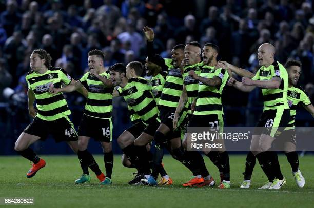 The Huddersfield Town team celebrate after Danny Ward of Huddersfield Town saves the final penatly to send them through to the final after the Sky...
