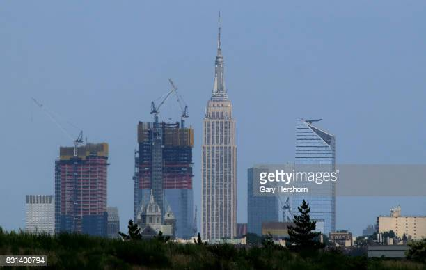 The Hudson Yards development rises in front of the Empire State Building in New York City on August 11 2017 as seen from Richard W DeKorte Park in...