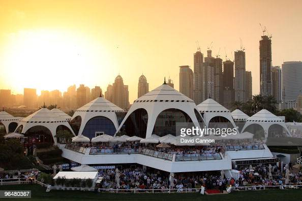 The huge crowds watch the big screen of the playoff from the clubhouse as the sun sets after the final round of the 2010 Omega Dubai Desert Classic...