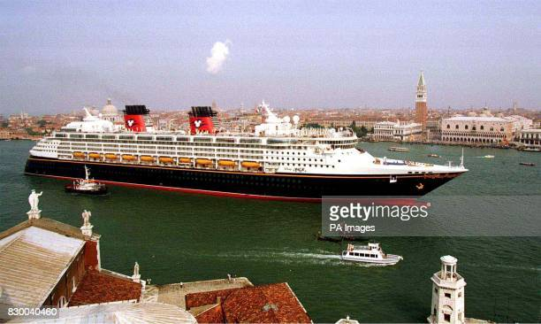 The huge Disney Magic cruise ship built in Italy flows through Venice's canal in front of St Marks Square 01 July as it departs for Port Canaveral...