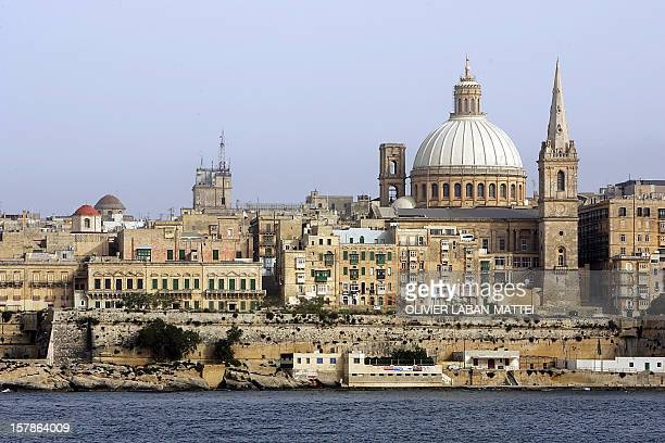The huge dome of the Carmelite Church and the spire of StPaul's Anglican are pictured in Valletta Malta 18 May 2005 Valletta is the capital city and...