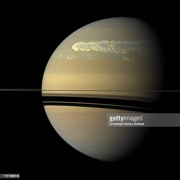 The huge storm churning through the atmosphere in Saturn's northern hemisphere overtakes itself as it encircles the planet in this truecolor view...