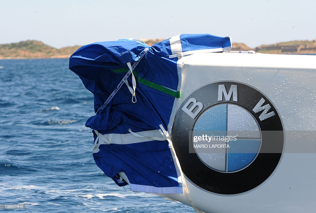 The hull of a boat crewed by the French Aleph team is covered by tarpaulin after a collision with a boat helmed by Italian team Azzura at the start of a Louis Vuitton Cup regatta on May 25, 2010 at La Maddalena island in Sardinia. Ten teams are battling it out over a two-week regatta until June 6.