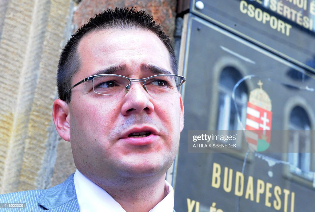 The Hungarian appointed lawyer Gabor Horvath, who represents former Nazi Laszlo Csatary, aka Ladislaus Csizsik-Csatary, leaves the courthouse in Budapest on July 18, 2012, after Laszlo was placed under house arrest for 30 days following questioning by an investigative judge at the military's prosecution's office. Meanwhile the Simon Wiesenthal Centre welcomed the arrest by Hungarian police of the Nazi war crimes suspect, who topped the US Nazi-hunting organisation's most wanted list. Csatary is accused by the Wiesenthal Center of having helped organise the deportation of some 15,700 Jews to the Auschwitz death camp during World War II.