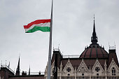 The Hungarian flag waves in front of the parliament building on February 1 2015 in Budapest Hungary Later in the day demonstrators will convene to...