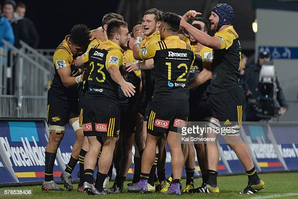 The Hurricanes celebrate after Beauden Barrett scores a try during the round 17 Super Rugby match between the Crusaders and the Hurricanes at AMI...