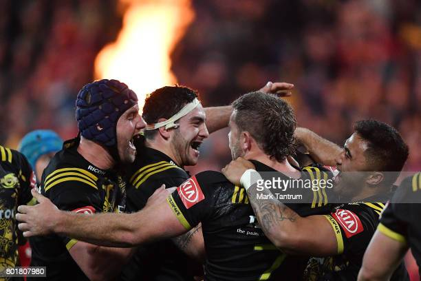 The Hurricanes celebrate Vaea Fifita of the Hurricanes try during the match between the Hurricanes and the British Irish Lions at Westpac Stadium on...