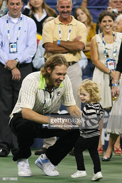 The husband of Kim Clijsters of Belgium Brian Lynch with daughter Jada after the Women�s Singles final between Clijsters and Caroline Wozniacki of...