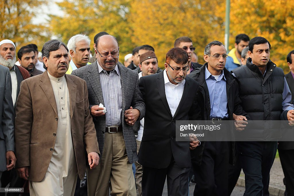 The husband of Sabah Usmani, Dr Abdul Shakoor (C), and members of the Muslim Community and friends and family of Sabah Usmani and her five children, who were killed in a house fire, follow the funeral cortege to the crematorium after a service of prayer on October 24, 2012 in Harlow, England. Dr Sabah Usmani and her sons Sohaib, 11, and Rayyan, 6, and daughter Hira, 13, died in a house fire in Harlow on October 15. Her other son, Muneeb, 9, and daughter Maheen, 3, both died later in hospital. Her husband, who was released from hospital last week, lead the funeral at Harlow Islamic Centre, which was attended by some 200 mourners.