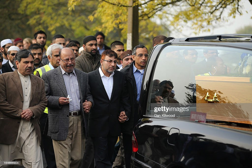 The husband of Sabah Usmani, Dr Abdul Shakoor (3rd L), and members of the Muslim Community and friends and family of Sabah Usmani and her five children, who were killed in a house fire, follow the funeral cortege to the crematorium after a service of prayer on October 24, 2012 in Harlow, England. Dr Sabah Usmani and her sons Sohaib, 11, and Rayyan, 6, and daughter Hira, 13, died in a house fire in Harlow on October 15. Her other son, Muneeb, 9, and daughter Maheen, 3, both died later in hospital. Her husband, who was released from hospital last week, lead the funeral at Harlow Islamic Centre, which was attended by some 200 mourners.