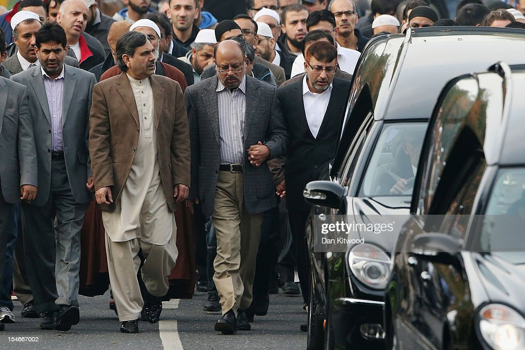 The husband of Sabah Usmani, Dr Abdul Shakoor (R), and members of the Muslim Community and friends and family of Sabah Usmani and her five children, who were killed in a house fire, follow the funeral cortege to the crematorium after a service of prayer on October 24, 2012 in Harlow, England. Dr Sabah Usmani and her sons Sohaib, 11, and Rayyan, 6, and daughter Hira, 13, died in a house fire in Harlow on October 15. Her other son, Muneeb, 9, and daughter Maheen, 3, both died later in hospital. Her husband, who was released from hospital last week, lead the funeral at Harlow Islamic Centre, which was attended by some 200 mourners.