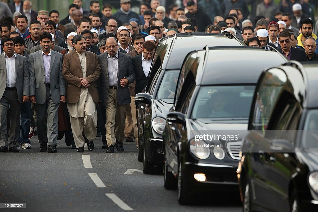 The husband of Sabah Usmani, Dr Abdul Shakoor (5th L), and members of the Muslim Community and friends and family of Sabah Usmani and her five children, who were killed in a house fire, follow the funeral cortege to the crematorium after a service of prayer on October 24, 2012 in Harlow, England. Dr Sabah Usmani and her sons Sohaib, 11, and Rayyan, 6, and daughter Hira, 13, died in a house fire in Harlow on October 15. Her other son, Muneeb, 9, and daughter Maheen, 3, both died later in hospital. Her husband, who was released from hospital last week, lead the funeral at Harlow Islamic Centre, which was attended by some 200 mourners.