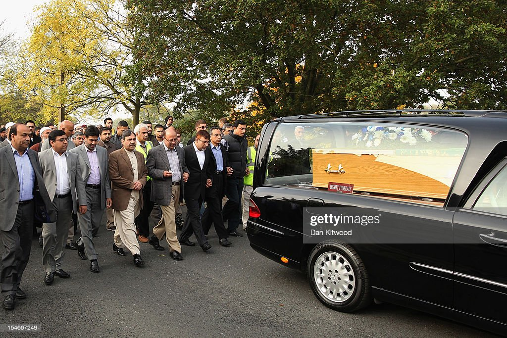 The husband of Sabah Usmani, Dr Abdul Shakoor (3rd R), and members of the Muslim Community and friends and family of Sabah Usmani and her five children, who were killed in a house fire, follow the funeral cortege to the crematorium after a service of prayer on October 24, 2012 in Harlow, England. Dr Sabah Usmani and her sons Sohaib, 11, and Rayyan, 6, and daughter Hira, 13, died in a house fire in Harlow on October 15. Her other son, Muneeb, 9, and daughter Maheen, 3, both died later in hospital. Her husband, who was released from hospital last week, lead the funeral at Harlow Islamic Centre, which was attended by some 200 mourners.