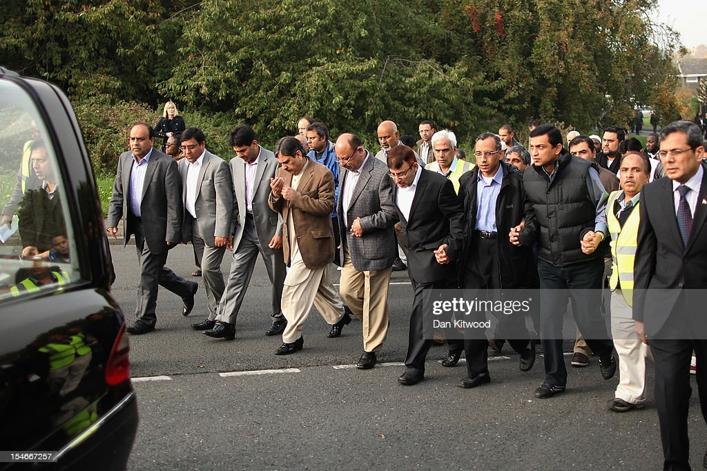 The husband of Sabah Usmani, Dr Abdul Shakoor (5th R), and members of the Muslim Community and friends and family of Sabah Usmani and her five children, who were killed in a house fire, follow the funeral cortege to the crematorium after a service of prayer on October 24, 2012 in Harlow, England. Dr Sabah Usmani and her sons Sohaib, 11, and Rayyan, 6, and daughter Hira, 13, died in a house fire in Harlow on October 15. Her other son, Muneeb, 9, and daughter Maheen, 3, both died later in hospital. Her husband, who was released from hospital last week, lead the funeral at Harlow Islamic Centre, which was attended by some 200 mourners.