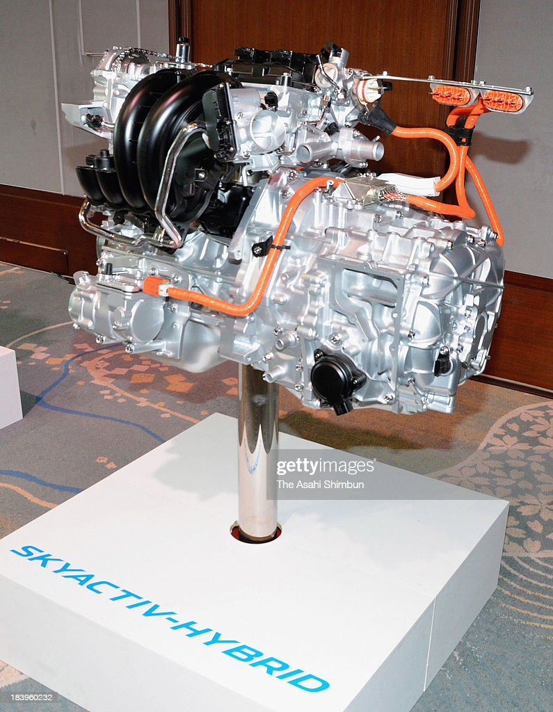The hybrid engine of Axela, Mazda's new car model is displayed during a press conference to announce its start of pre-orders in Japan on October 9, 2013 in Tokyo, Japan. The model combines an electric system provided by Toyota Motor Corp and a 2,000cc engine using Mazdafs original Skyactiv technology. Axela is Mazda's first hybrid car.