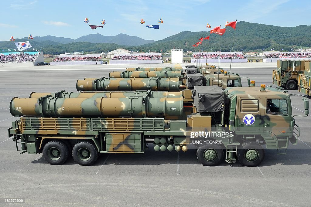 The Hyeonmu 3, an indigenously developed South Korean cruise missile capable of a surgical strike on North Korea, is on parade during a ceremony marking the 65th anniversary of the founding of South Korea's Armed Forces at an air base in Seongnam, south of Seoul, on October 1, 2013. The missile which was first deployed on naval destroyers in November last year was shown as South Korea staged its largest military display for a decade. AFP PHOTO / JUNG YEON-JE
