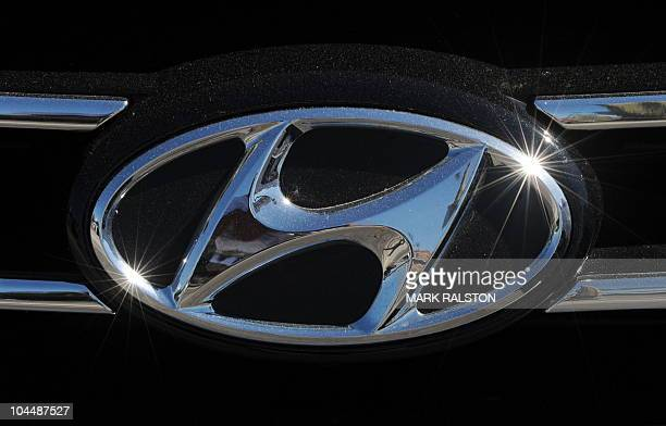 The Hyundai emblem at a Hyundai dealership in Los Angeles on September 27 2010 South Korea's top automaker Hyundai Motor is recalling nearly 140000...