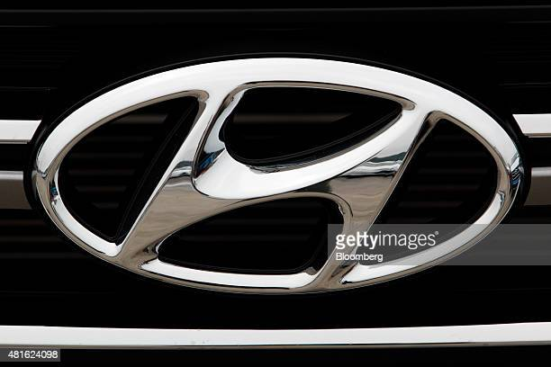 The Hyundai Motor Co badge is displayed on the front grille of a vehicle at a port near the company's Ulsan plant in Ulsan South Korea on Tuesday...