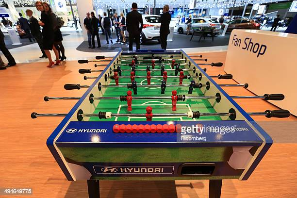 The Hyundai Motor Co logo sits on a fussball table at the Auto Mobil International automotive trade fair at Leipziger Messe in Leipzig Germany on...