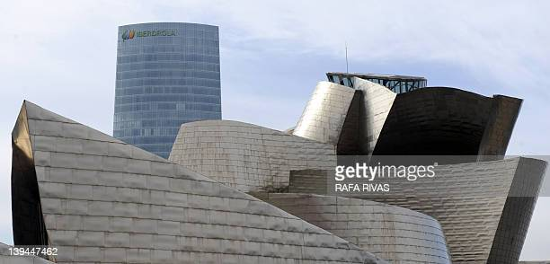 The Iberdrola Tower building is seen behind the Guggenheim Bilbao museum on February 21 in the Northern Spanish Basque city of Bilbao The building...